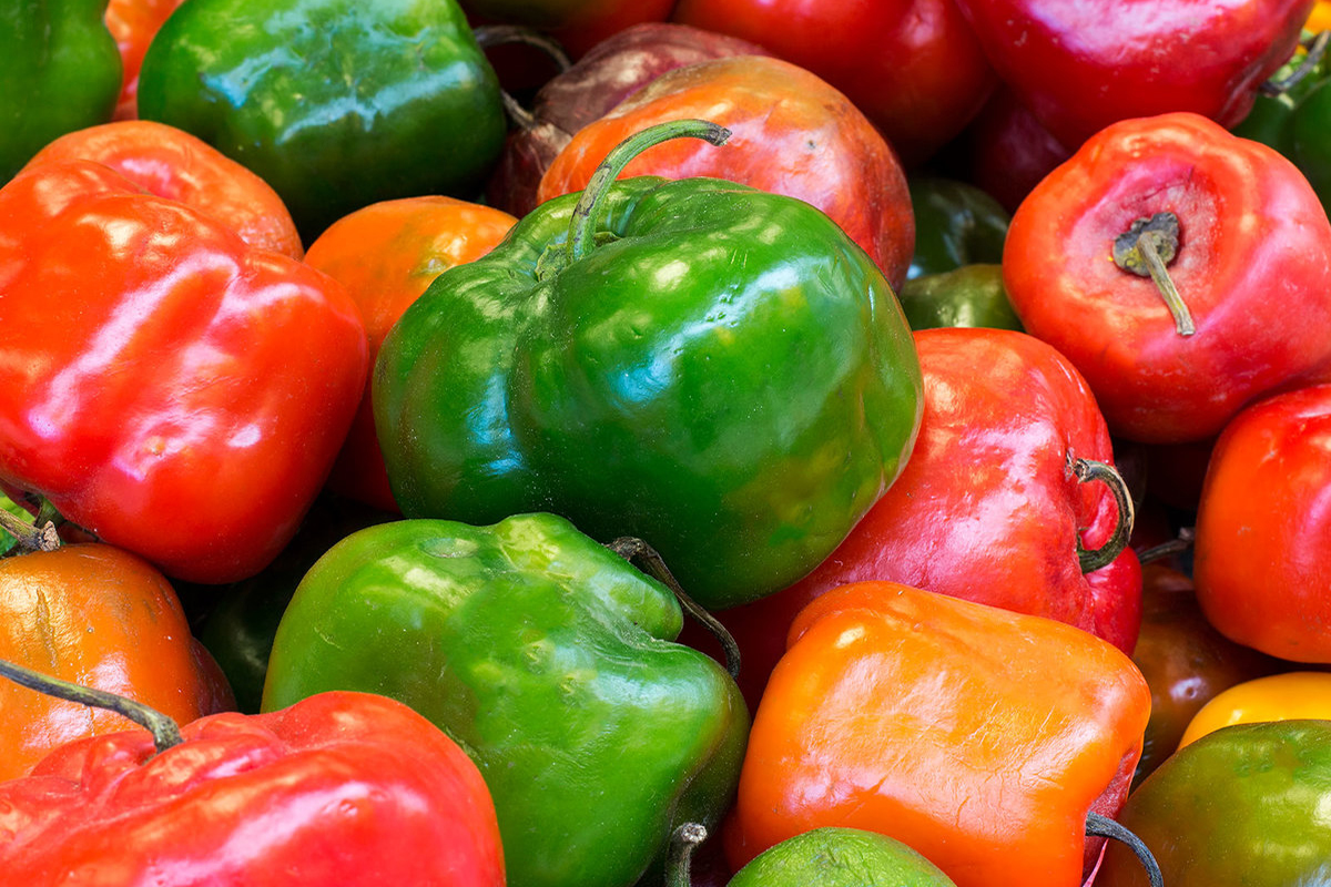 "Red, green and yellow chilli pepper from Peru called ""rocoto"" in a market. Natural look."